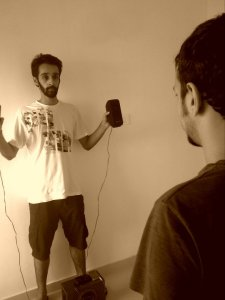 "Akshay holding the speakers and Kuber finding the sweet spot in the ""studio""."